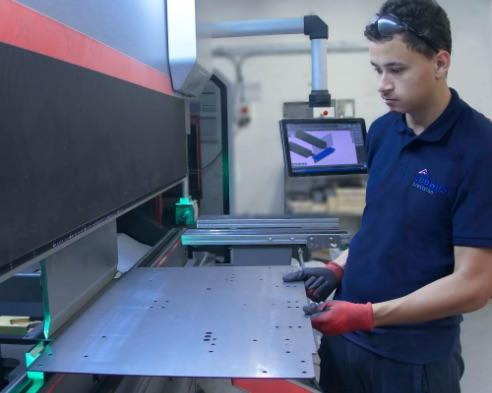 Ludwick worker using a machine